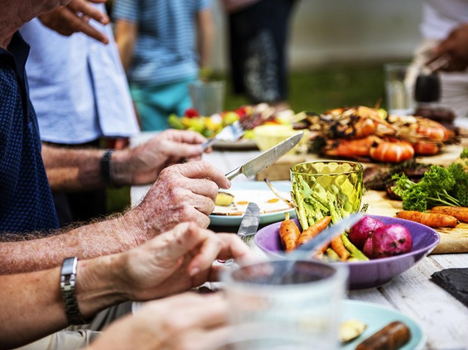 closeup-of-diverse-people-enjoying-barbecue-party-together